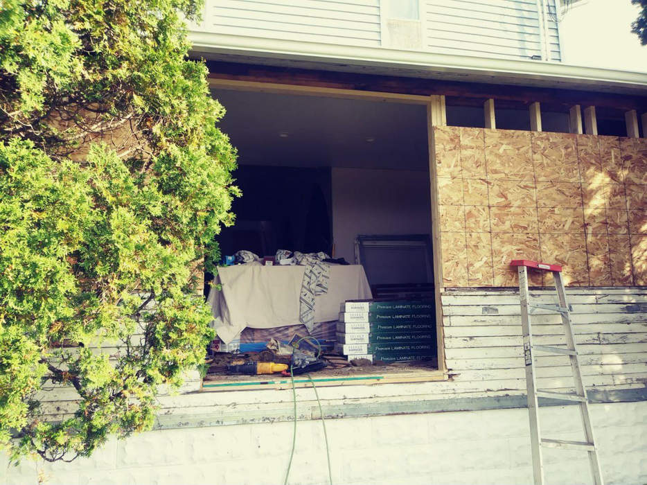 Wall teardown for new stairs and door installation by Hercules Construction LLC in Rockford